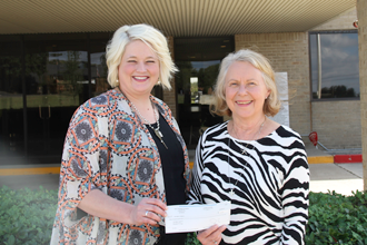 One Mans Treasure web TVEC Public Relations Representative Laura Melton presents a grant check to Annette Jenkins from One Man's Treasure.