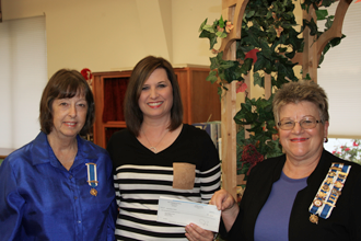 TVEC Public Relations Representative Joy Long, right, presents a grant check to Linda Mynar, left, and Susan Martz-Cothran from the Sarah Maples Chapter.